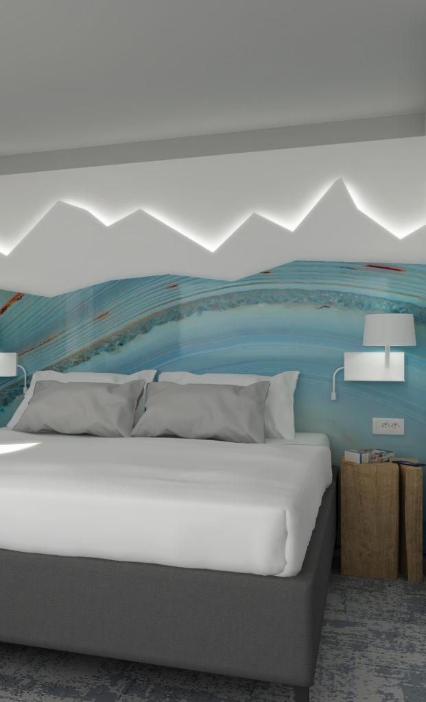 Tête de lit en forme de montagnes enneigées dans les chambres