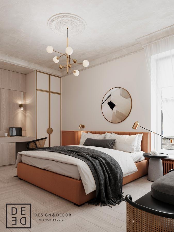 Un lit en velours de couleur terracotta