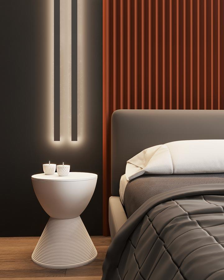 Une chambre moderne grise avec une tête de lit en acier de couleur terracotta