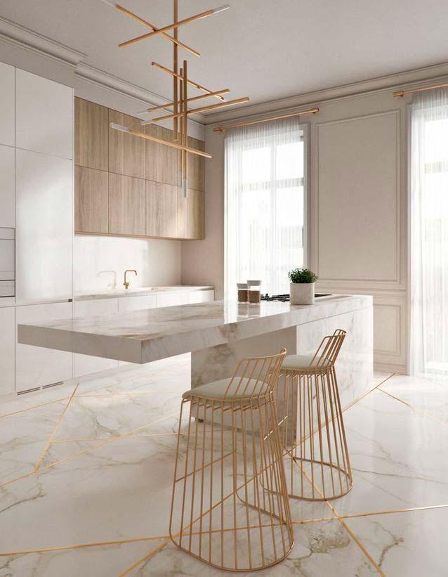 Décoration d'une cuisine design en marbre blanc et dorée effet kintsugi
