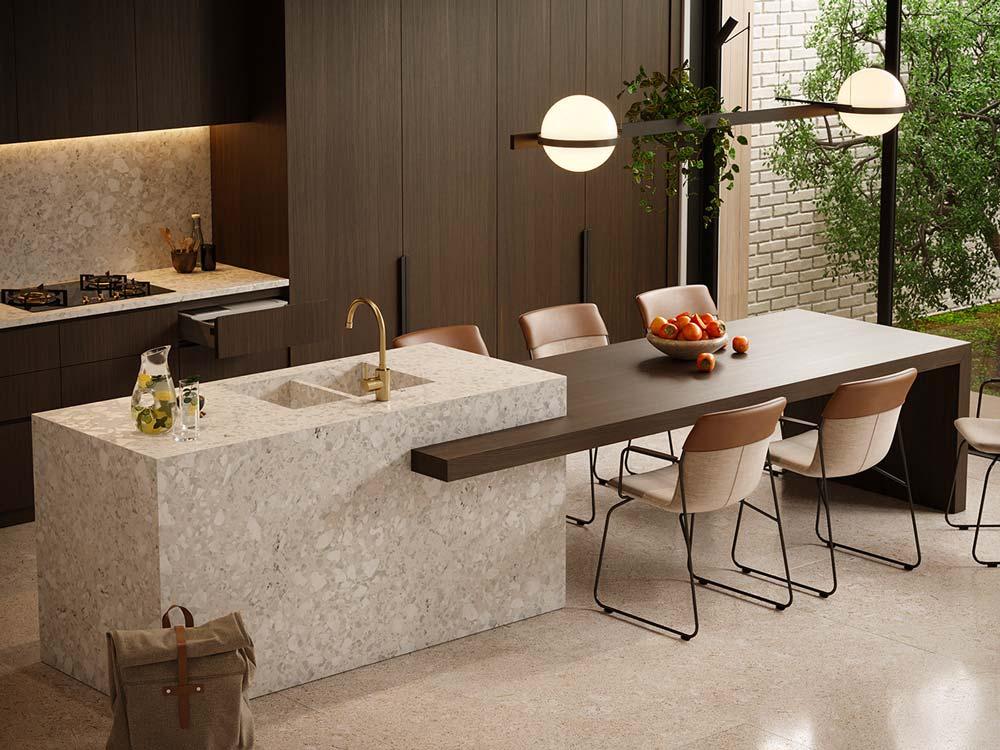 Une cuisine tendance et contemporaine en bois exotique, îlot central en terrazzo monochromatique ultra design
