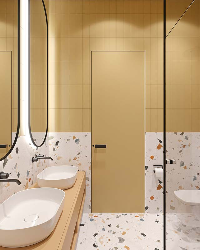 Salle de bain vintage et miniamliste de couleur jaune pastel, sol en terrazzo à gros motifs