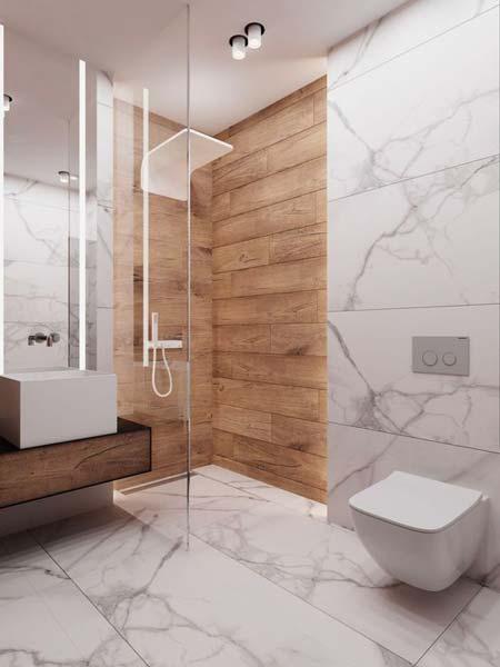Salle de bain design qui mélange le marbre blanc et un carrelage effet bois