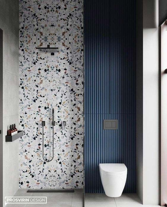 Salle de douche et wc contemporain avec un pan de mur terrazzo et en béton teinté bleu