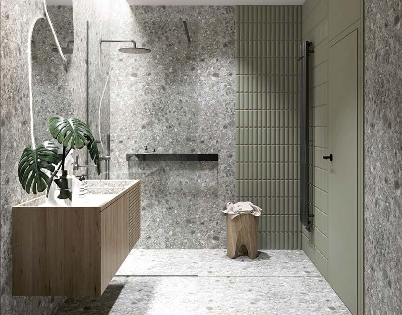 Une salle de douche en total look terrazzo gris avec un mur kaki et du mobilier en bois
