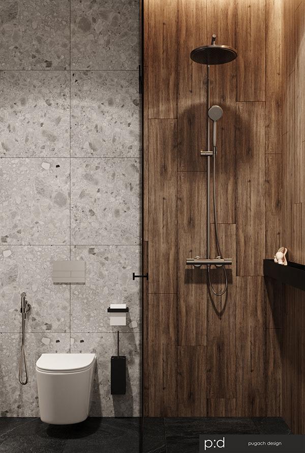 Une salle de douche en terrazzo monochromatique avec un carrelage imitation bois