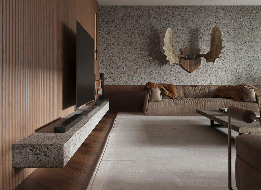 Un salon contemporain et minimaliste avec un pan de mur en terrazzo et un meuble tv en terrazzo