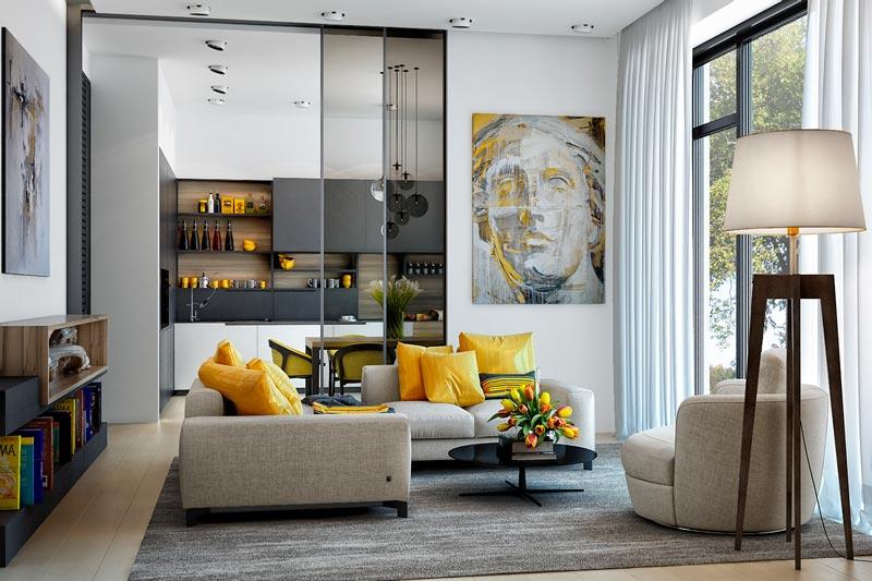 Salon et cuisine ultra tendance et contemporain avec un canapé gris souris et des coussins jaune solaire
