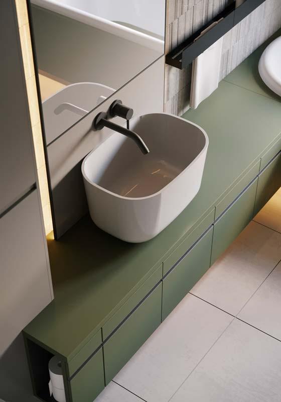 Une salle de bain avec un meuble vasque kaki mat