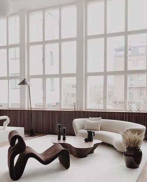 Salon design, canapé en laine bouclée arrondi, fauteuil aux formes contemporaines et organiques