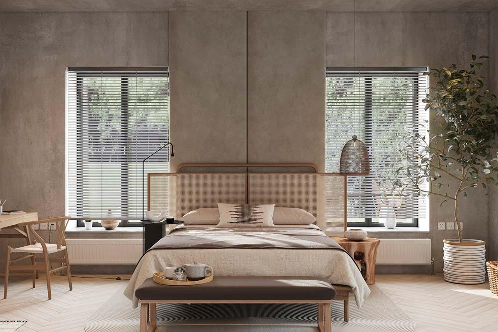Une chambre japandi avec du béton brut au mur et une tête de lit en cannage