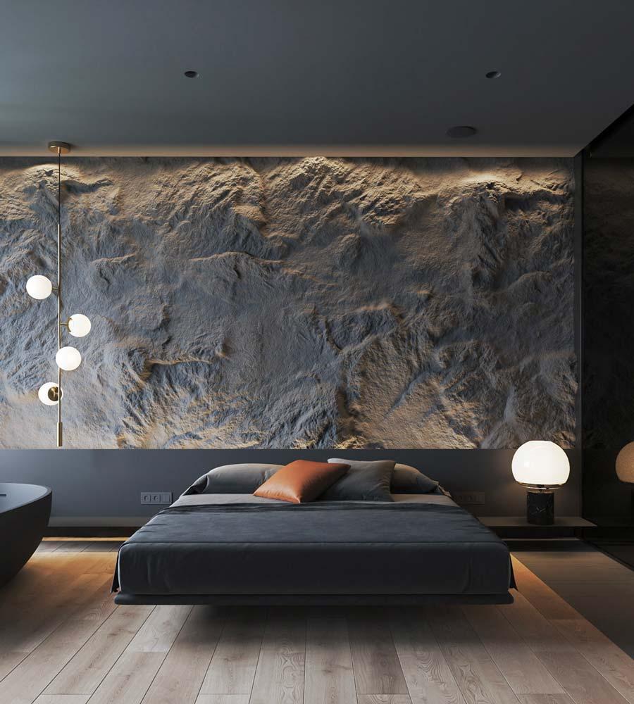 Une chambre foncée noire, mobilier contemporain et tête de lit en pierre effet roché noir