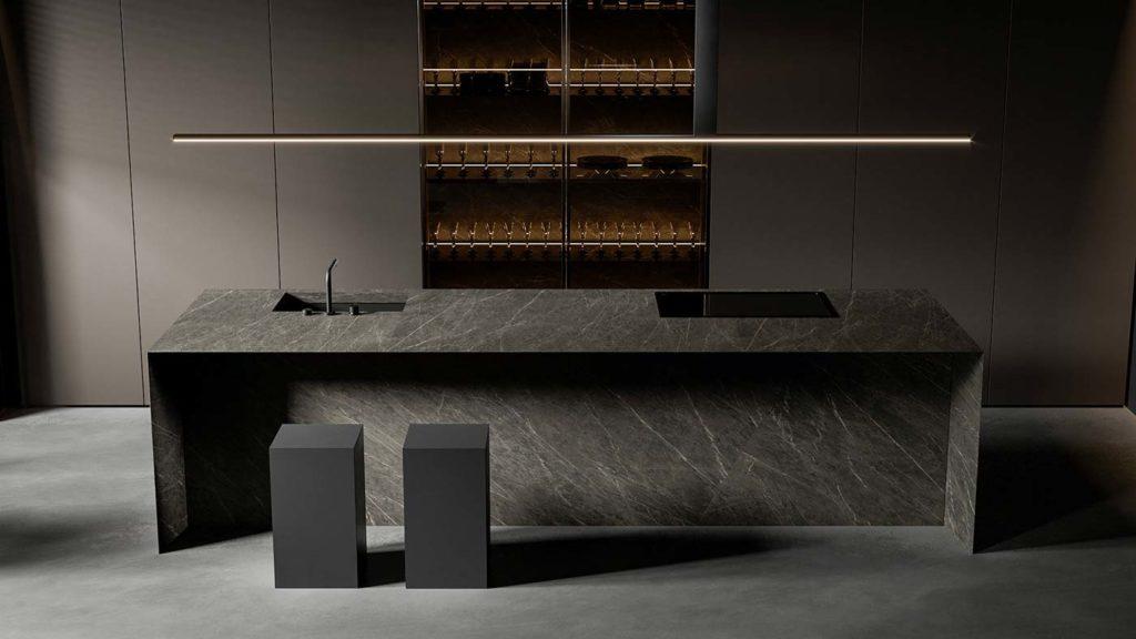 Une cuisine minimaliste noires avec un îlot central en marbre noir