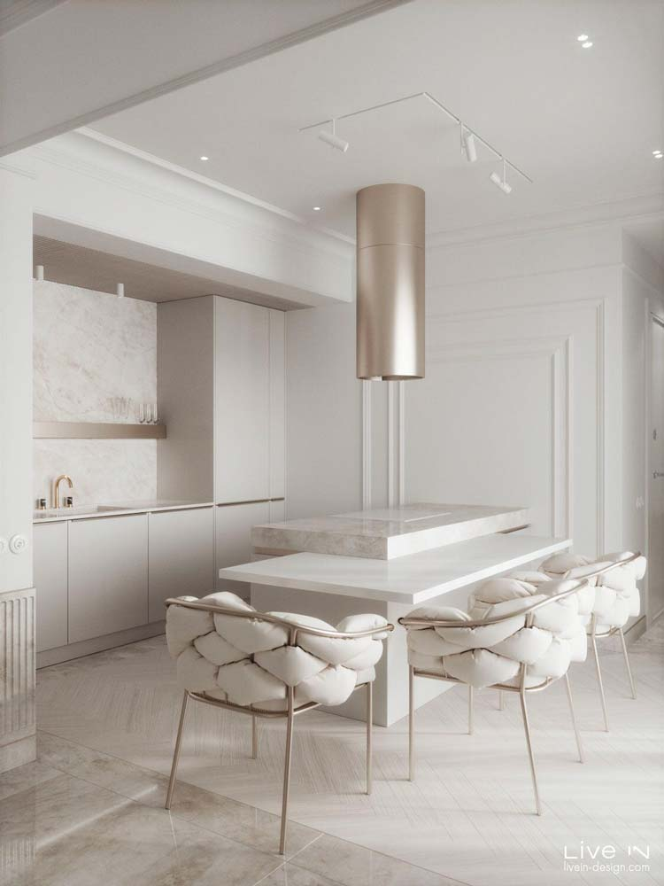 Une cuisine ultra design et confortable blanche avec des accessoires rose gold