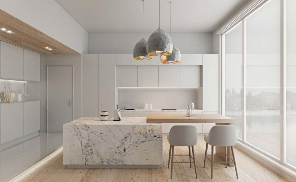 Une cuisine total blanc avec îlot central en marbre blanc