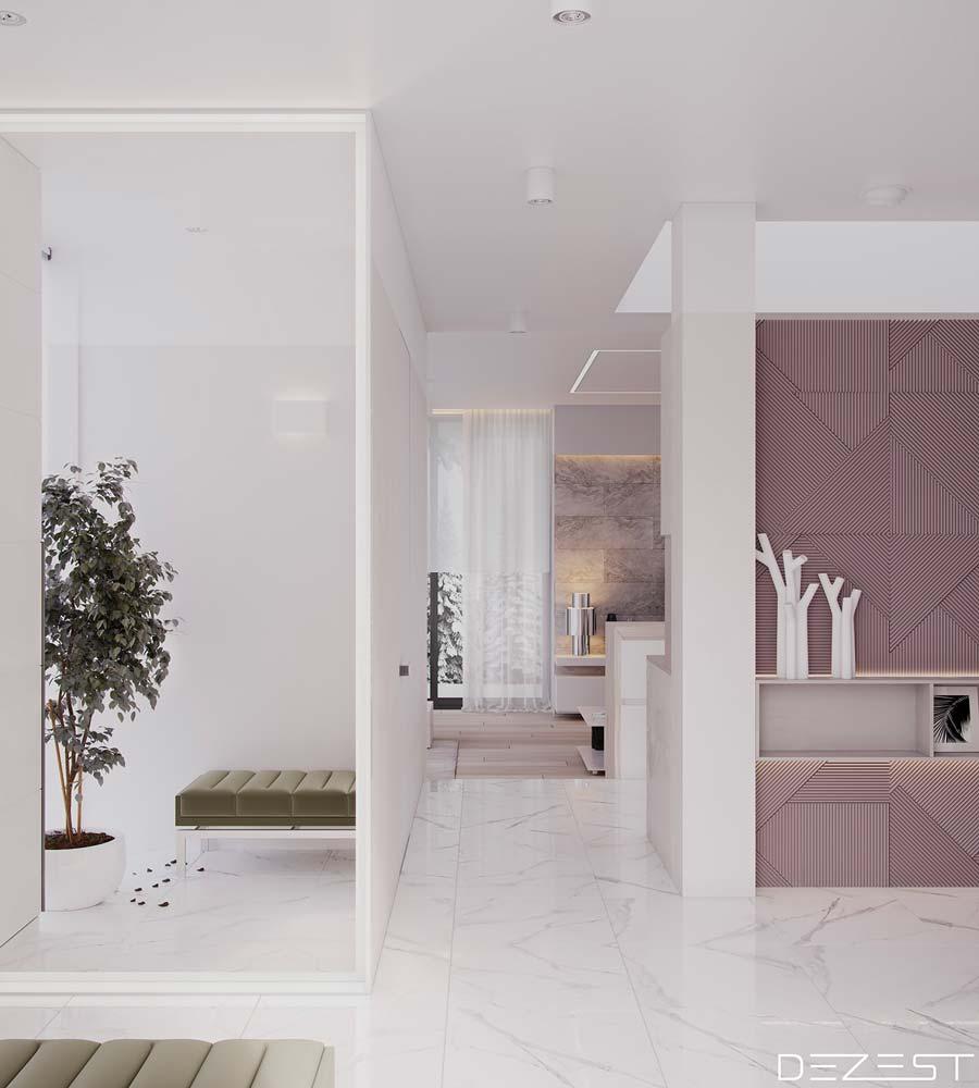 Une entrée très lumineuse avec un sol en marbre blanc et des touches de rose poudrée