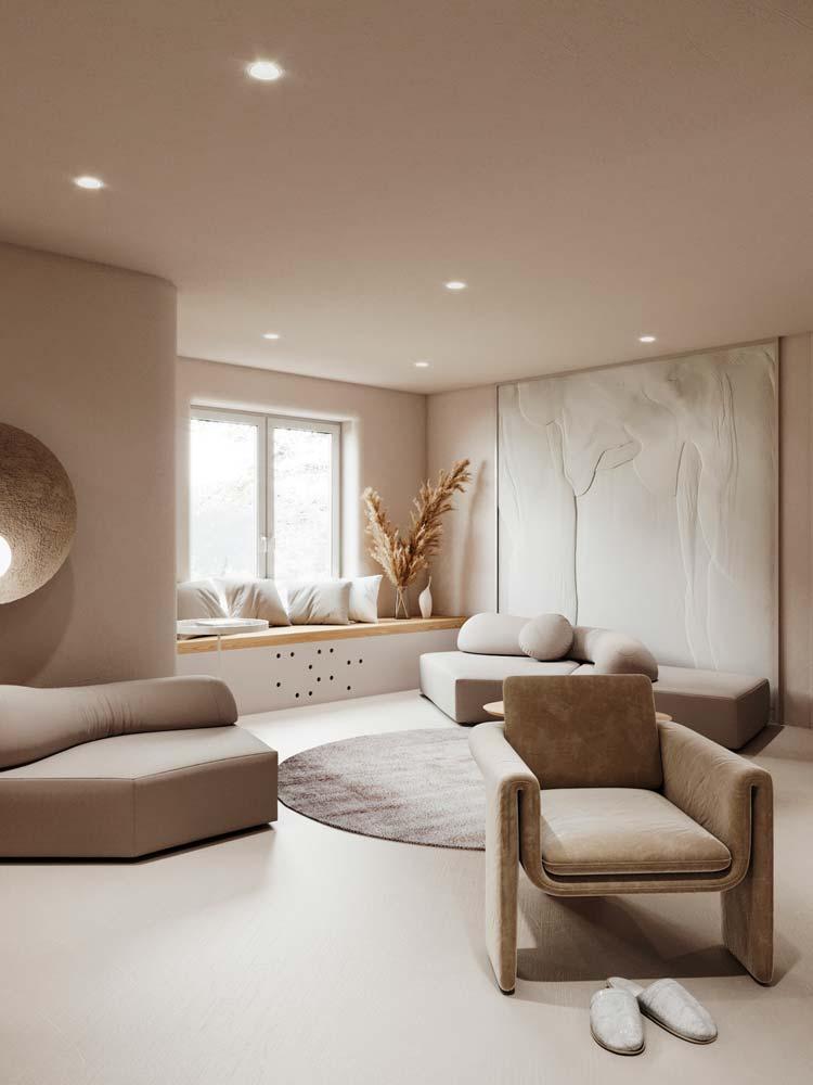 Salon minimaliste et chaleureux aux mobiliers arrondis, fauteuil en velours