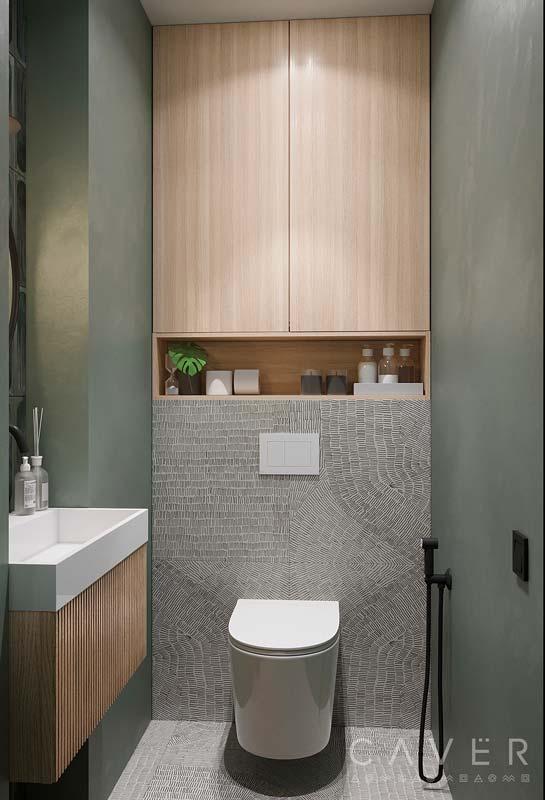Des toilettes kaki, grise avec un placard en bois