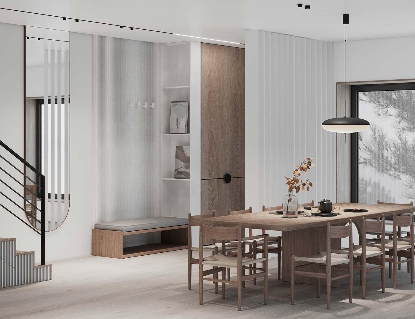 Une salle à manger minimaliste très lumineuse. Décoration blanche et bois