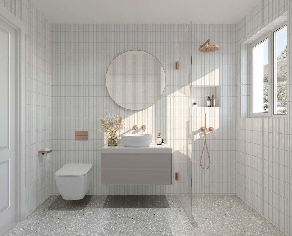 Une salle de bain ultra design blanche avec de la robinetterie en cuivre rose gold