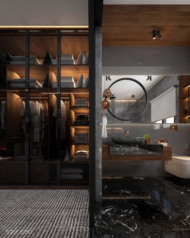 Une salle de bain en bois foncé avec revêtement en acier alvéolé. Dressing noir et bois