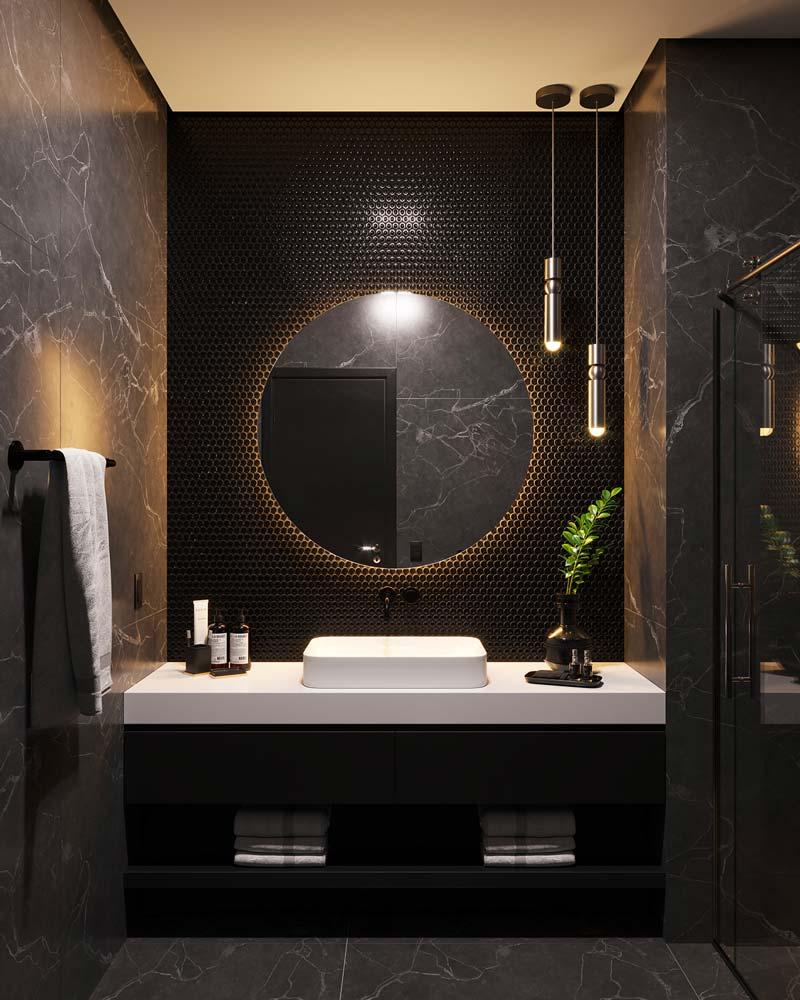 Salle de bain en marbre noir moderne avec plan vasque blanc