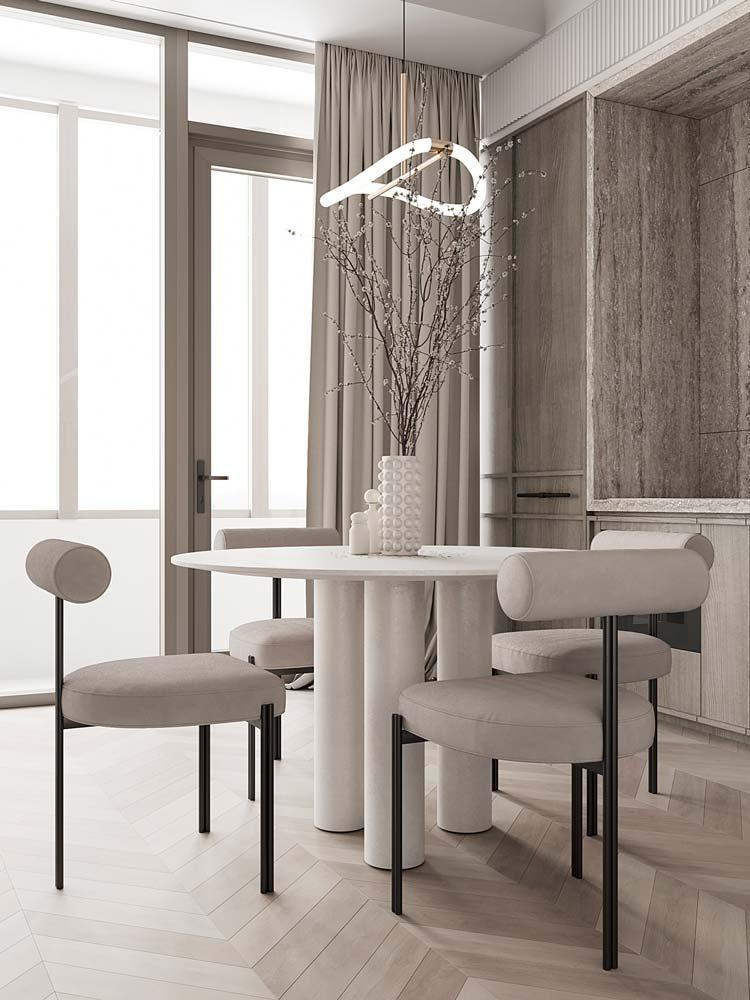 Salle à manger minimaliste et chic avec une table ronde blanche à 3 pieds