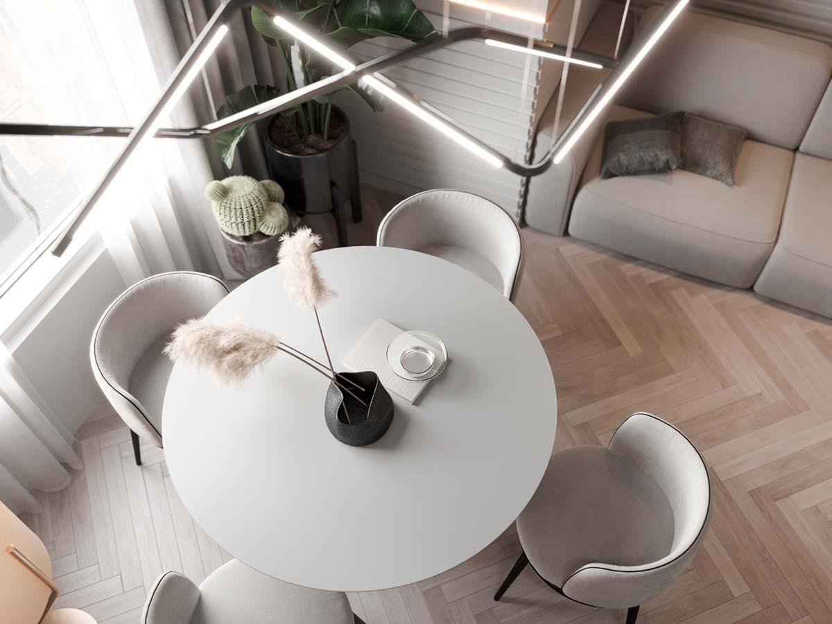 intérieur minimaliste clair avec une table ronde blanche et des chaises arrondies