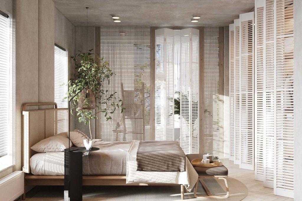 Une chambre Japandi écrue et minimaliste avec des portes persiennes