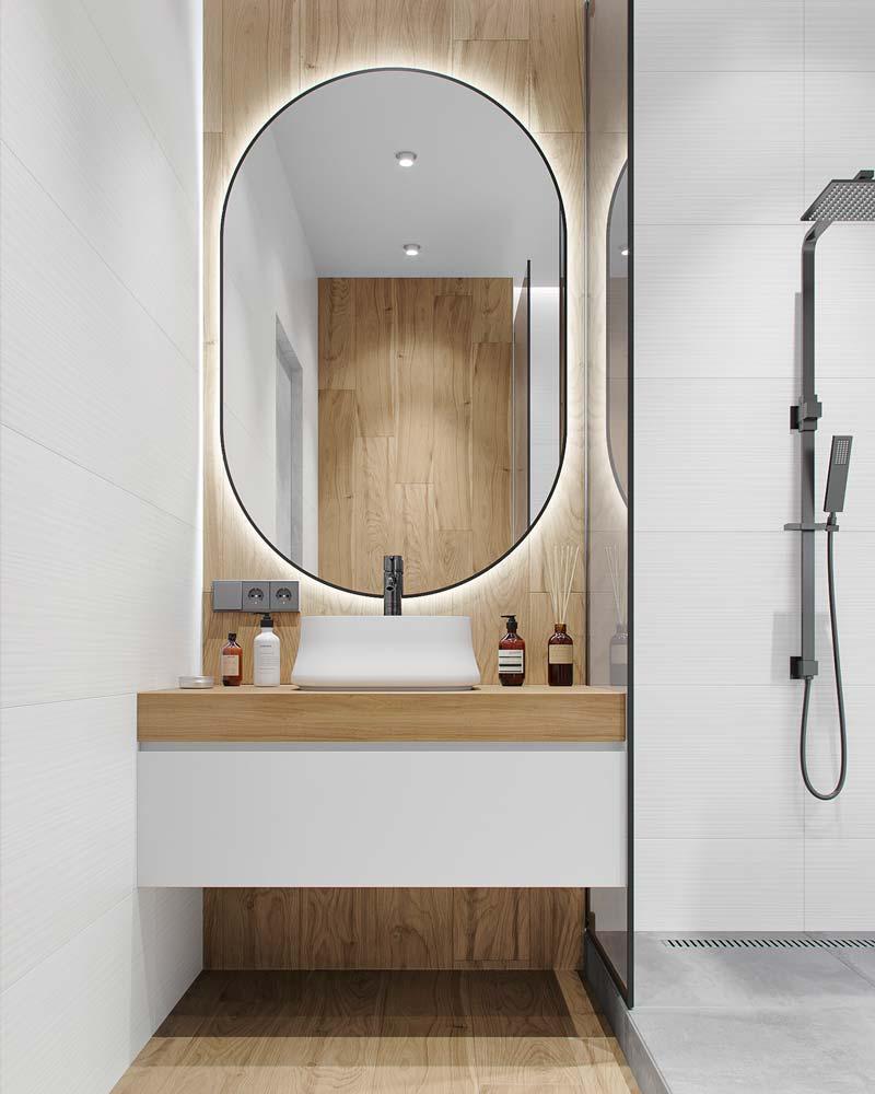 Une salle de bain moderne blanche et bois avec miroir à néon ovale