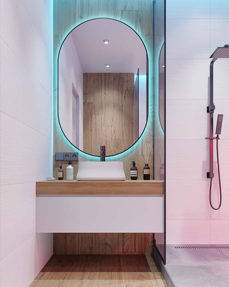 Salle de bain moderne bois et blanche éclairée par des néons bleu et rose