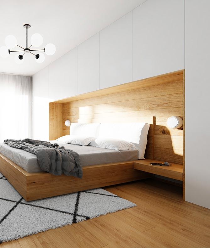 Une niche en bardage en bois dans une tête de lit