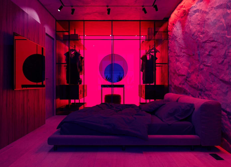 Une chambre parentale moderne éclairée par des néons de couleur la nuit