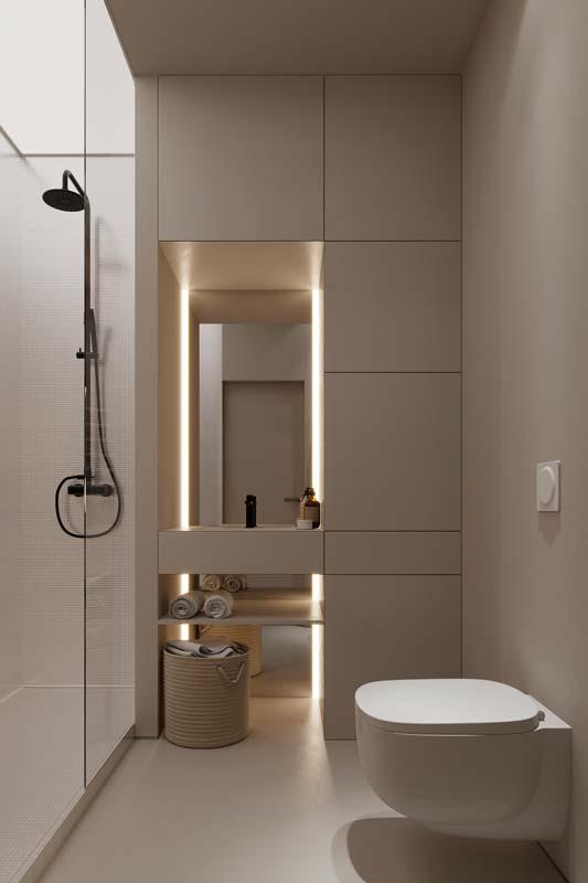 Une salle de bain minimaliste blanche avec un éclairage néon blanc