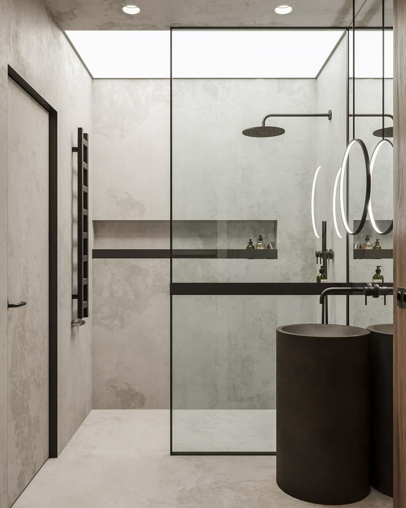 Une salle de bain industrielle avec un miroir rond rétroéclairé par des néons