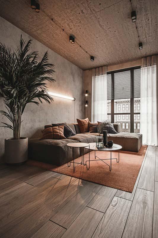 Salon industriel avec un plafond en béton brut et un éclairage néon