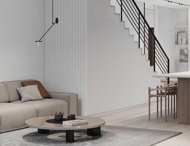 Salon minimaliste habillé d'un bardage intérieur en bois blanc
