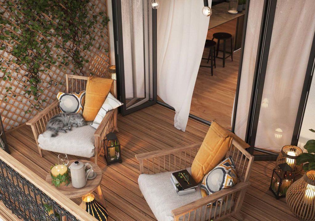 Un balcon chaleureux en bois avec des fauteuils confortables, un beau plancher, des lanternes en déco et un mur en treillis végétal