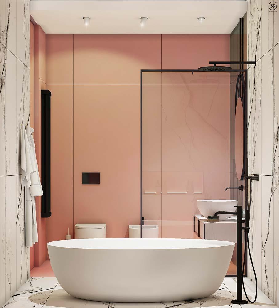Une salle de bain blanche et vieux rose avec du marbre et de la robinetterie noire