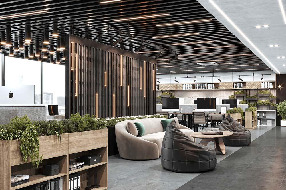 Un coin détente d'entreprise avec des canapés et fauteuils confortables et des meubles en bois chaleureux