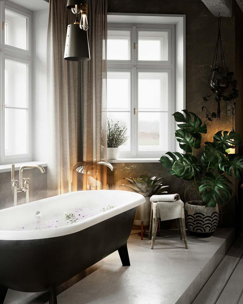 Une salle de bain sobre avec une baignoire et de la robinetterie dorée à côté de plantes vertes et d'un rideau brun
