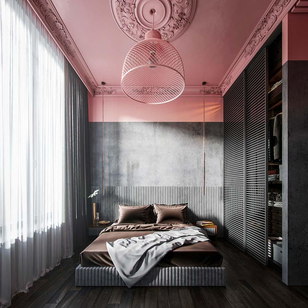 Une chambre classique rose et grise avec un plafond ornementé et un plancher sombre