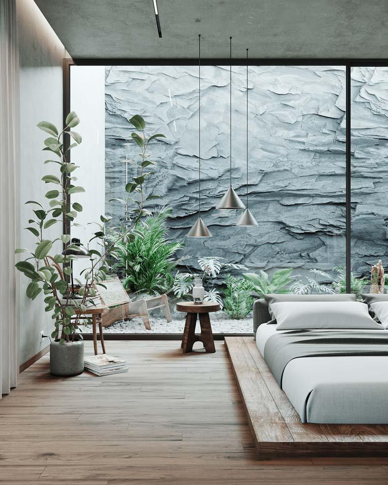 Une décoration sobre avec de la verdure et un tabouret table de nuit en bois brut pour une chambre slow living