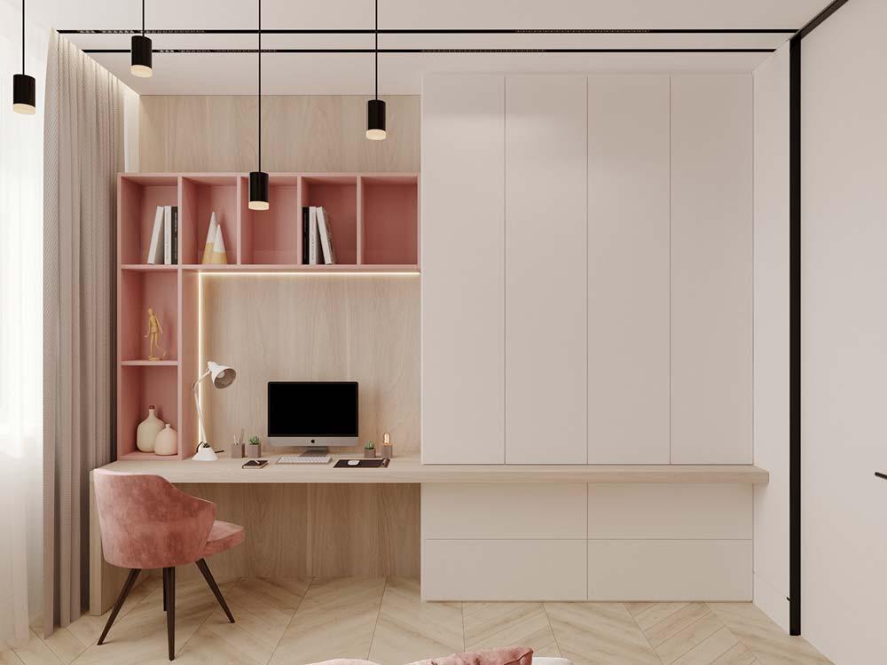 Un bureau girly blanc et rose avec des meubles en bois et un fauteuil en velours