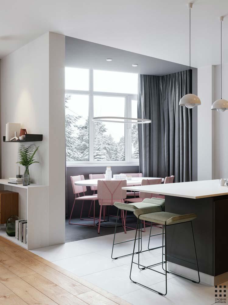 Une cuisine moderne lumineuse avec des chaises roses et kaki