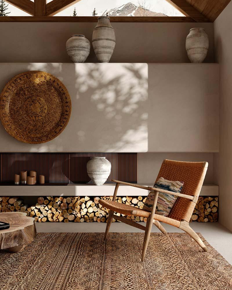 Un coin salon slow life avec un tapis, un fauteuil et des vases en argile en décoration