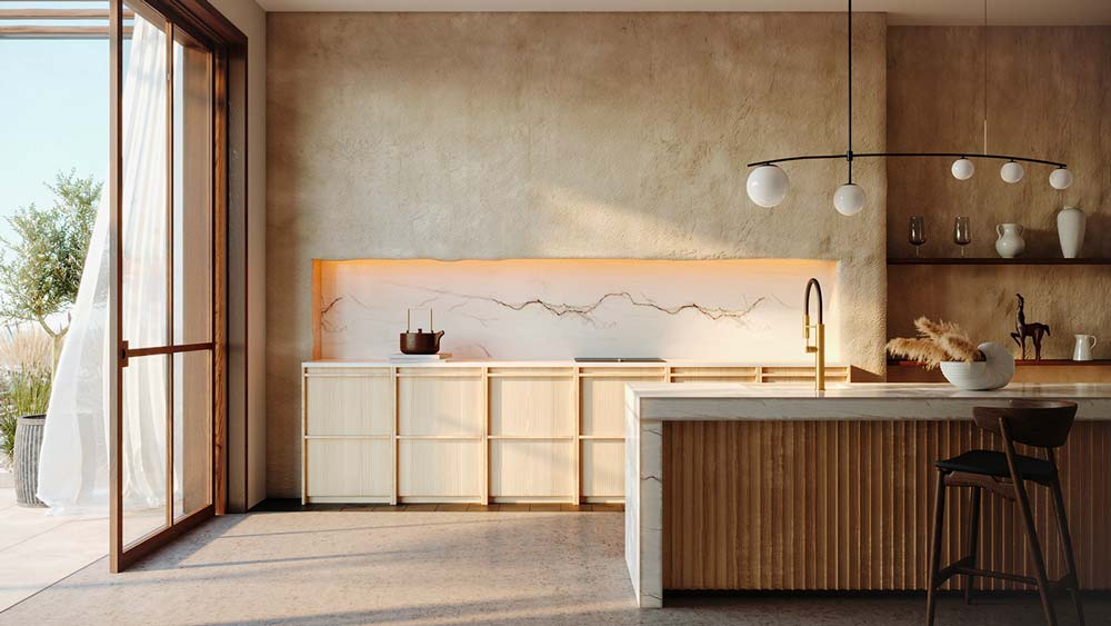 Une cuisine slow life avec du marbre, du bois, un îlot central avec évier et un mur couleur ocre en tadelakt