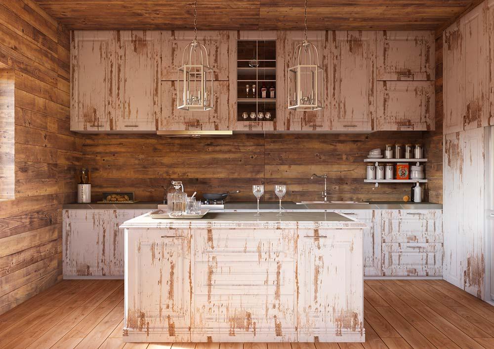 Du mobilier de cuisine blanchi à l'aspect ancien et des suspensions lumineuses en fer forgé blanc