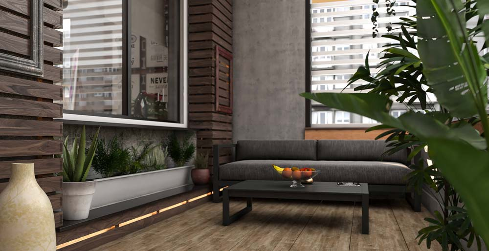 Un balcon moderne qui mélange du béton et du bois avec un canapé noir et quelques plantes vertes