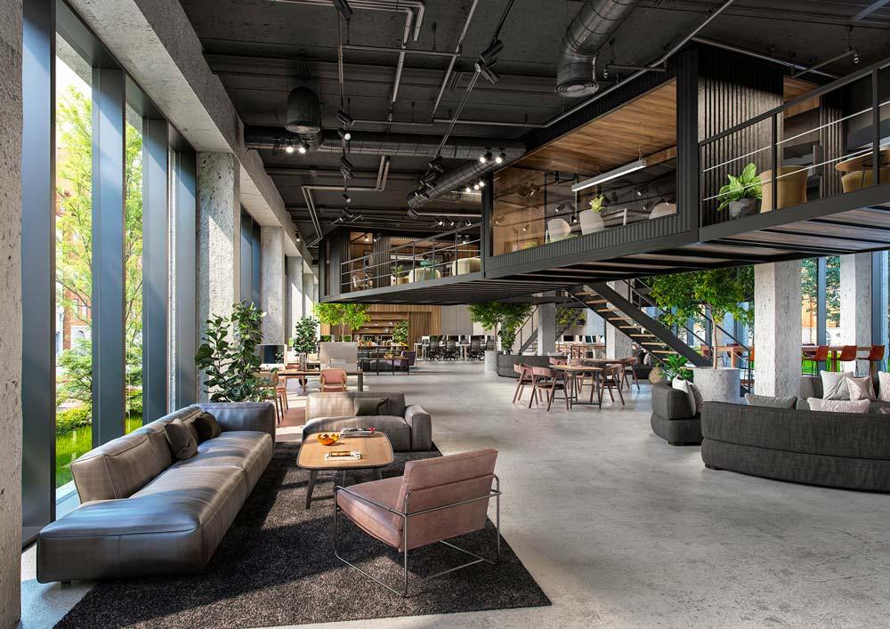 Un intérieur d'entreprise industriel mais chaleureux avec des tapis, des canapés, et un étage décoré de bardage en bois